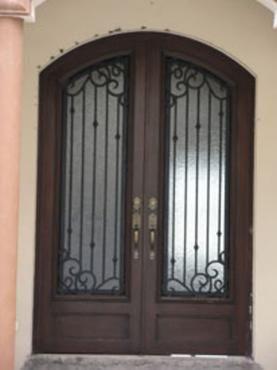 Forja y herreria puertas principales de forja for Imagenes puertas de herreria para exterior