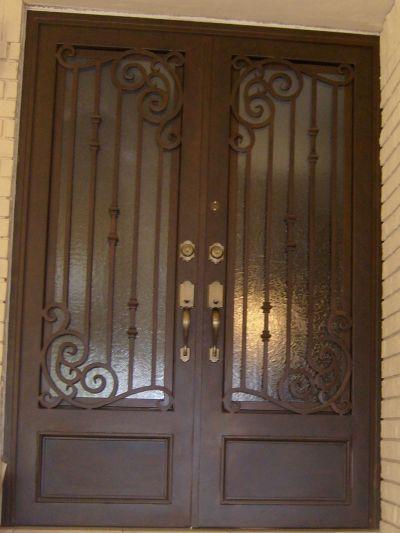 Puerta portones ventanas protectores forja xico genuardis for Puertas principales de madera