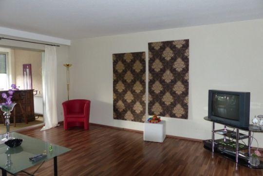 Wohnbereich mit Fernseher FeWo Beate Nitz