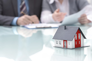 How hard is it to refinance your home with bad credit