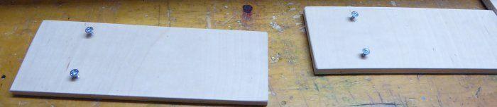 Leimholzplattenrest mit reingeschraubten Schrauben