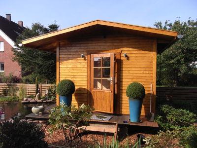 Zimmerei Sven Gerlach - Gartenhaus mit kleiner Terrasse